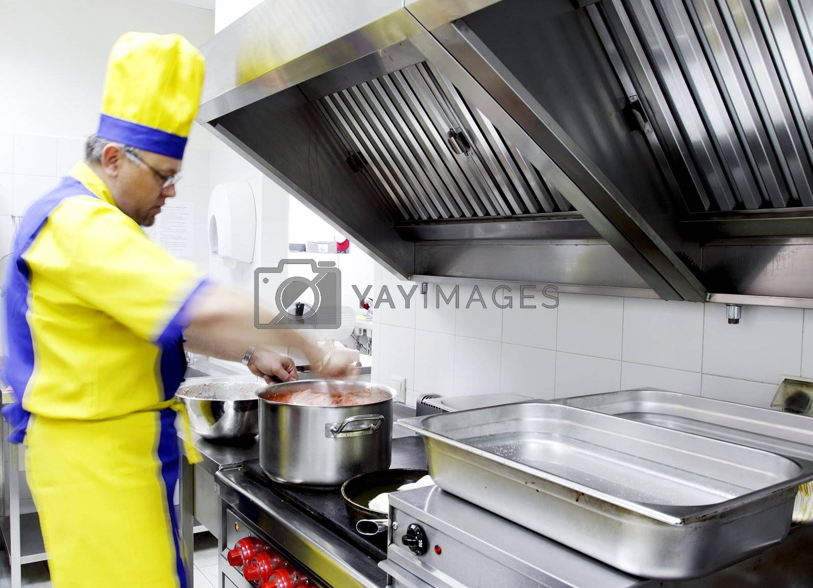 a cook preparing a dish on the stove