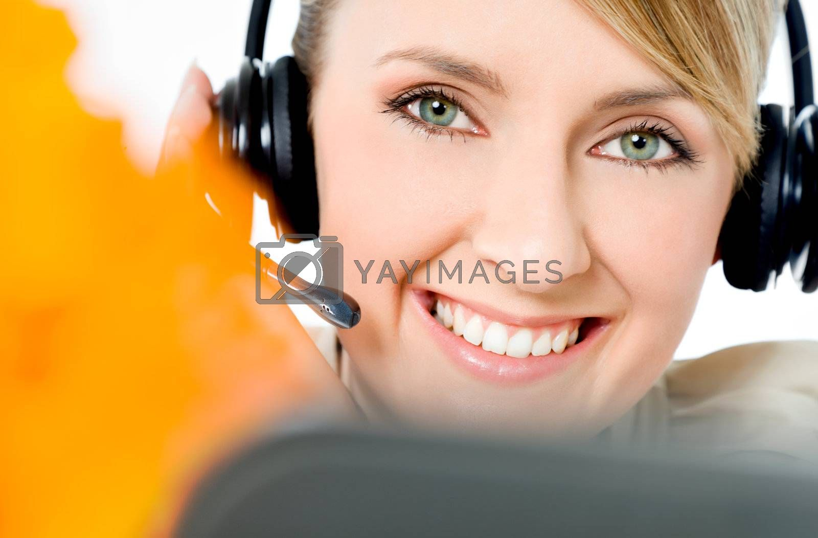 Portrait of beautiful smiling call center woman, looking at camera