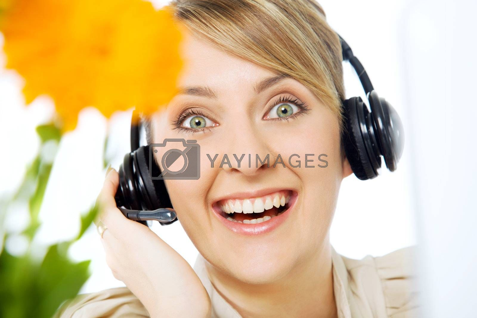 Portrait of  beautiful smiling excited call center woman with headset