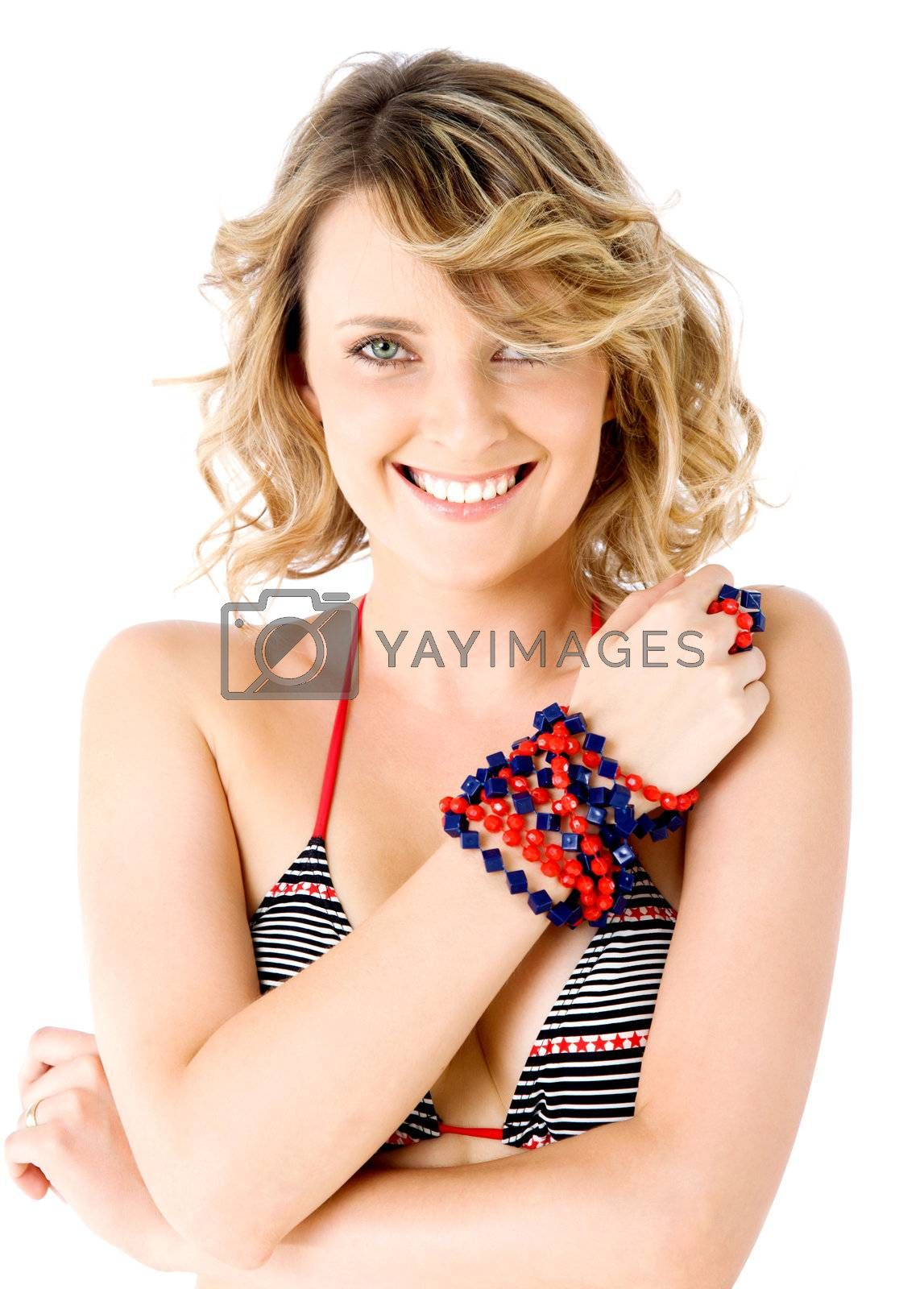 Portrait of  beautiful smiling female in swimsuit, isolated on white