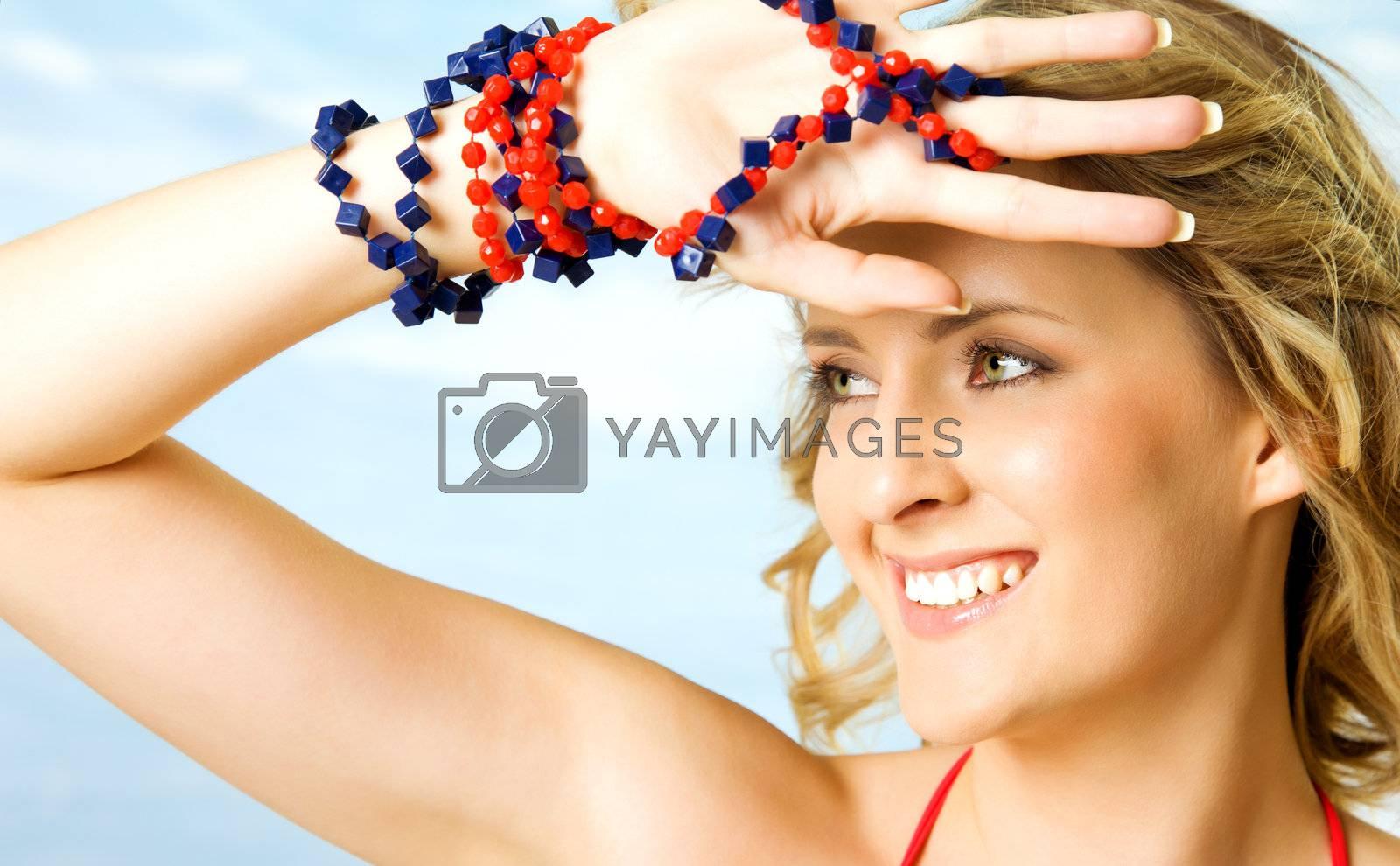 portrait of beautiful blonde woman under bright light