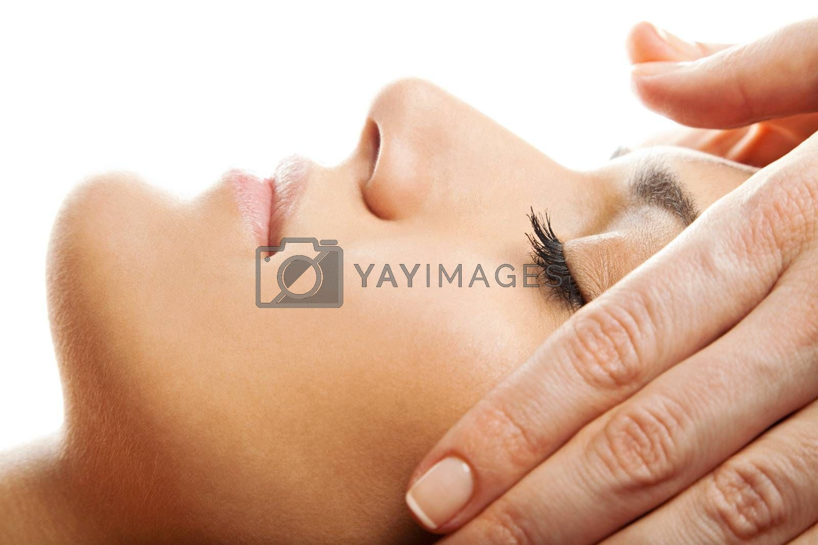 profile close-up of a beautiful  woman  face receiving massage isolated