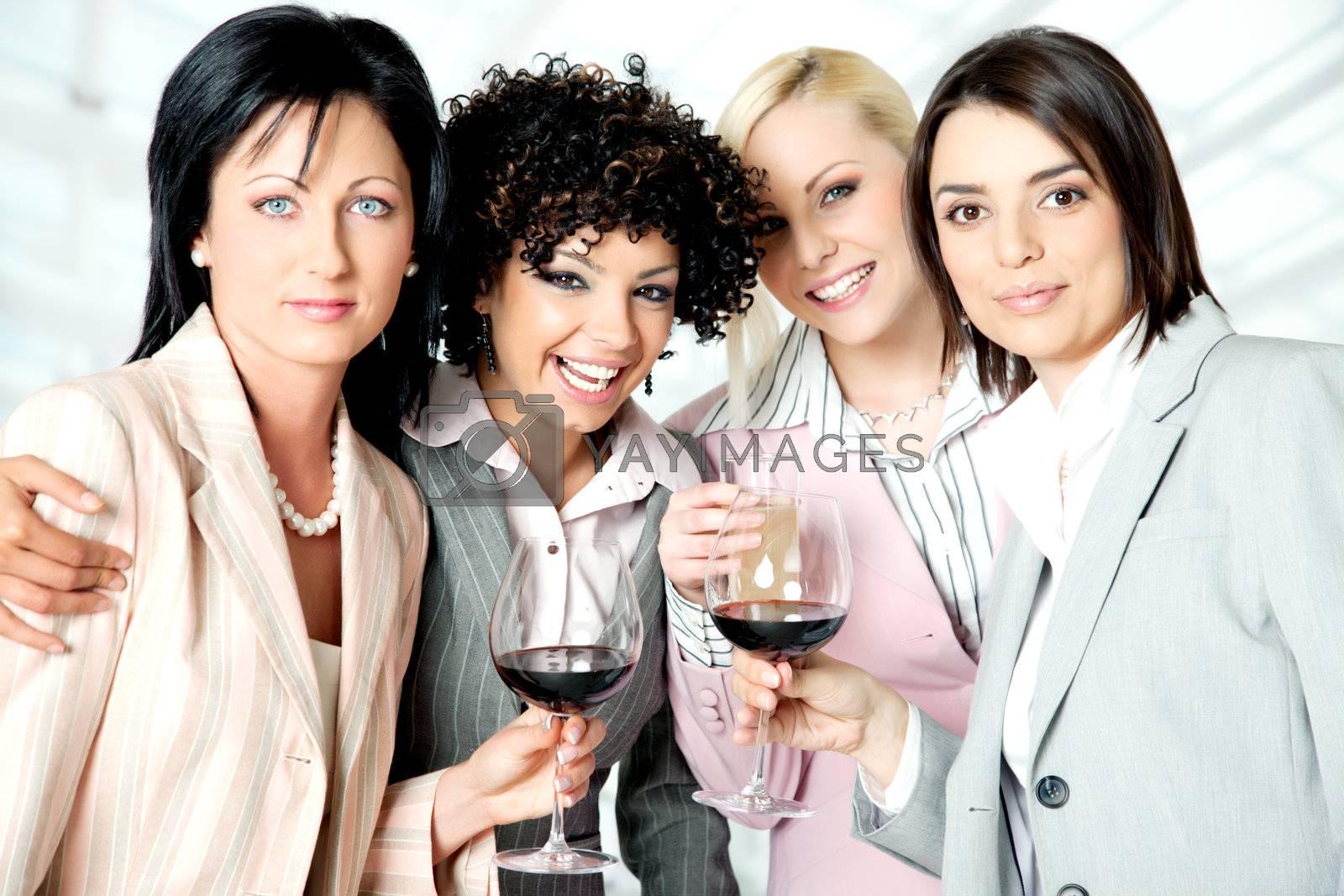 Team of four beautiful successful businesswomen celebrating