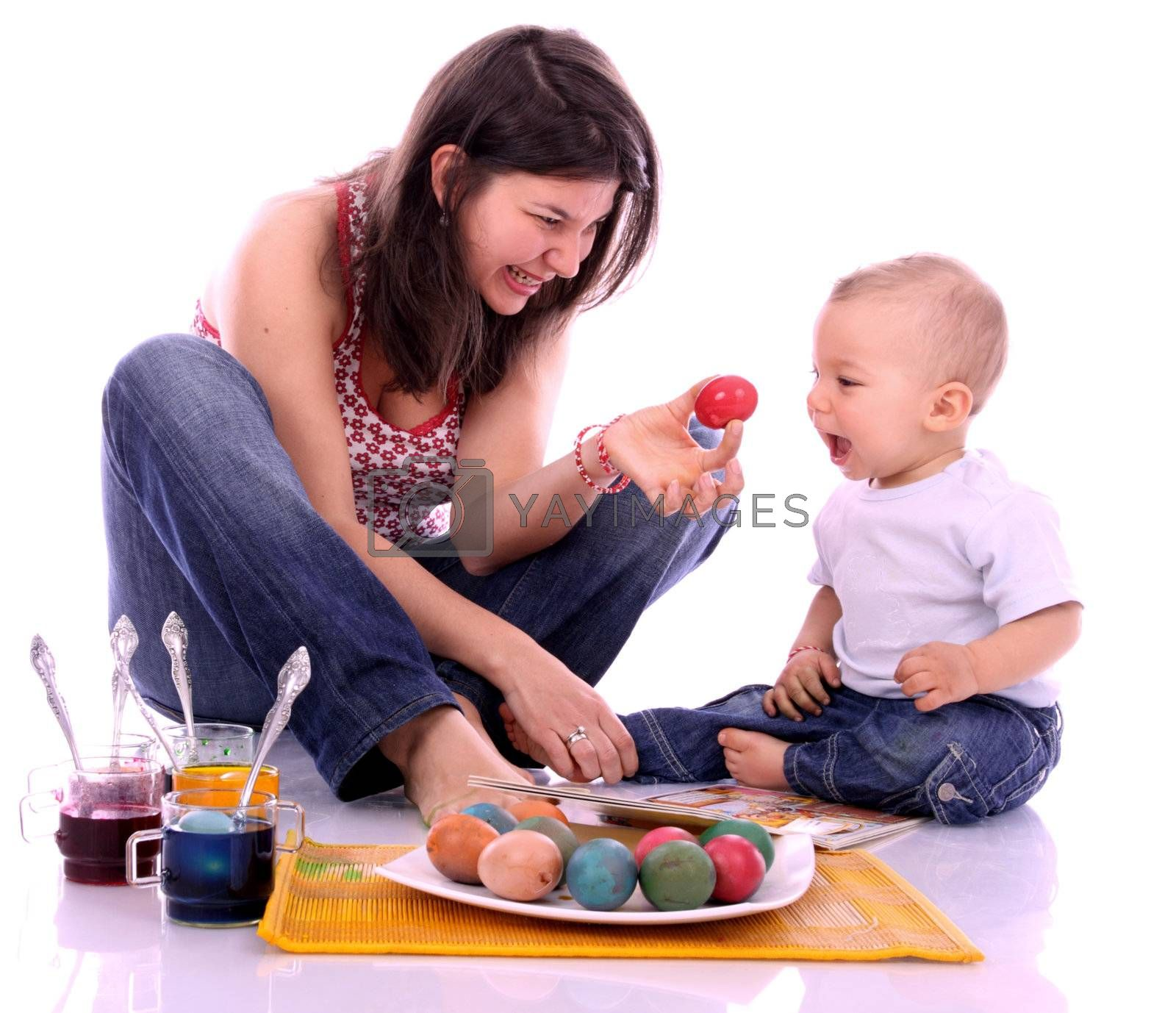 Happy mother and son preparing Easter eggs