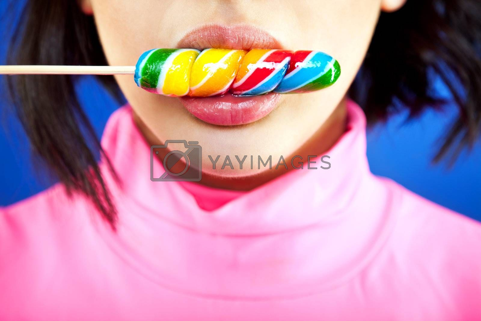 Close-up of a girl's mouth licking a lollipop
