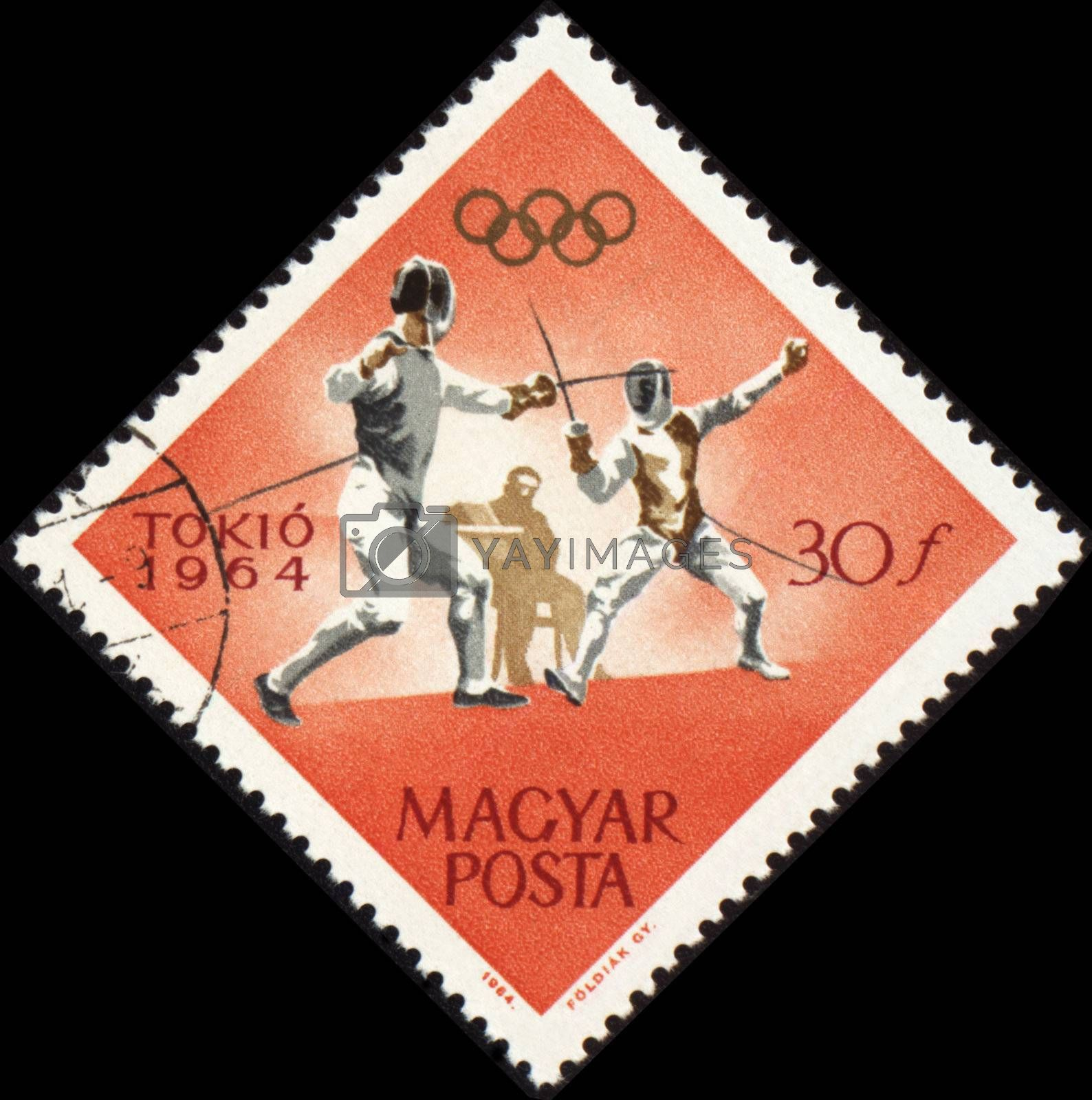 HUNGARY - CIRCA 1964: A post stamp printed in Hungary shows fencing, devoted to Olympic games in Tokio, series, circa 1964