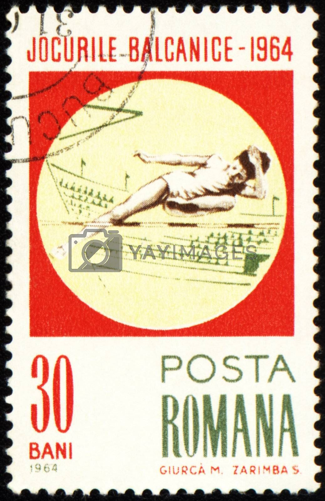 ROMANIA - CIRCA 1964: A post stamp printed in Romania shows high-jumper, devoted to Balkan games, series, circa 1964