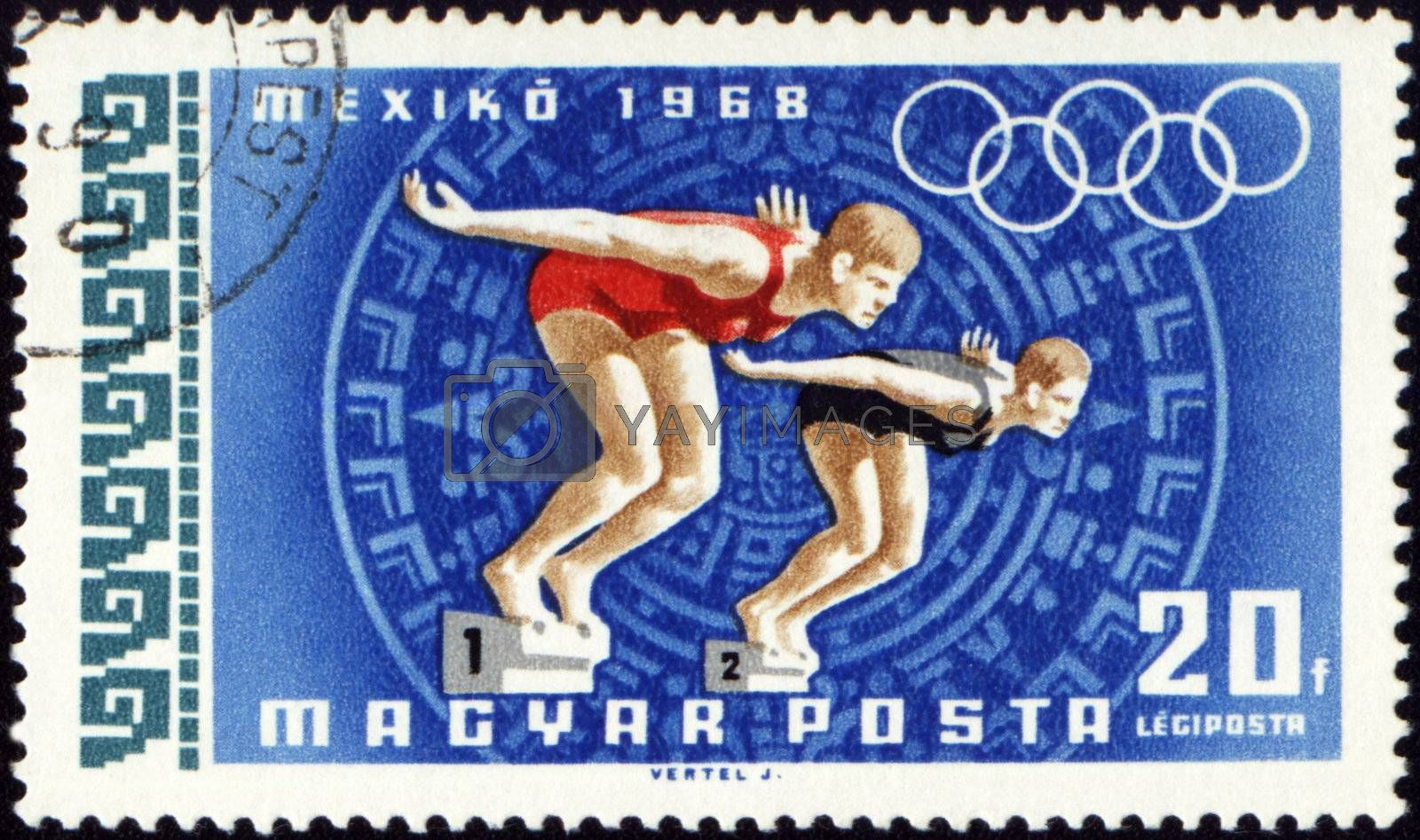 HUNGARY - CIRCA 1968: A post stamp printed in Hungary shows two jumping swimmers, devoted to Olympic games in Mexico, series, circa 1968