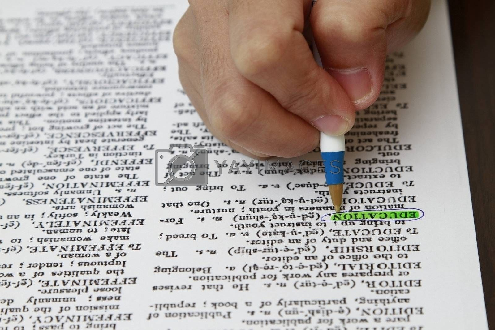 The word education highlighted with a pen.