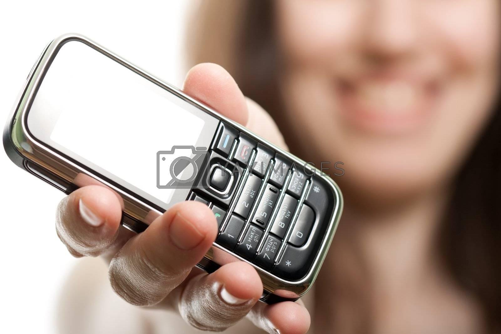 Smiling women holding mobile communication phone