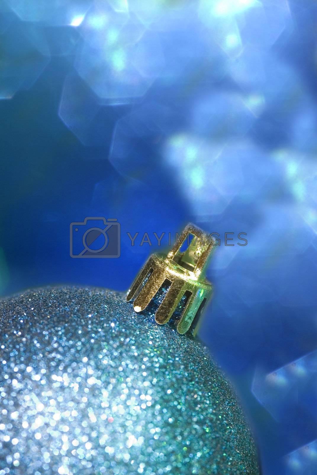 vertical blue Christmas ball in defocused