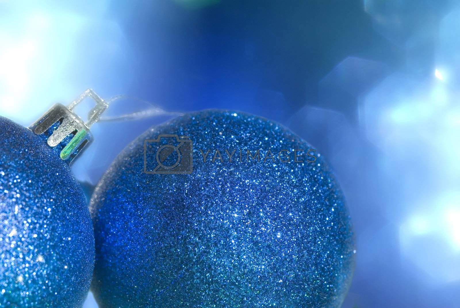 Christmas card two bright blue ball in background blur