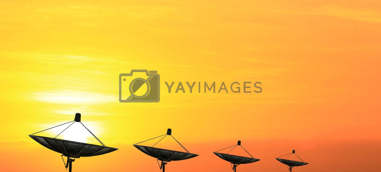 black antenna communication satellite dish over sunset sky
