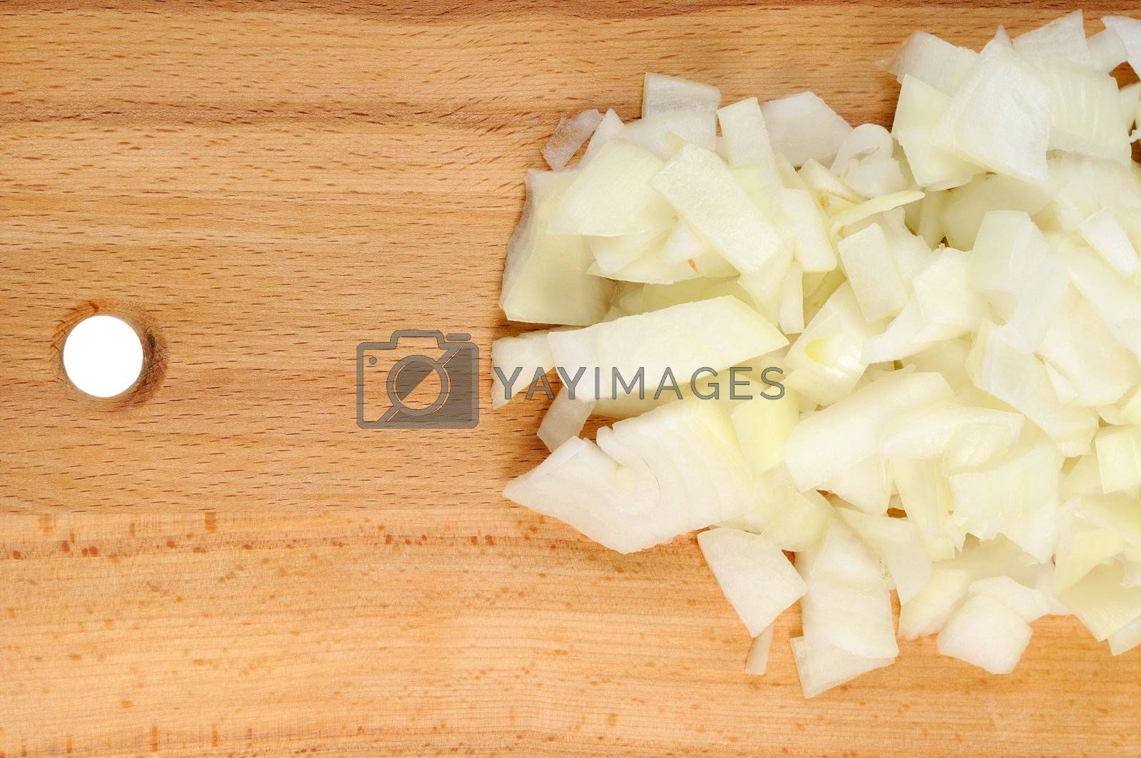 Chopped onions on a wooden board.