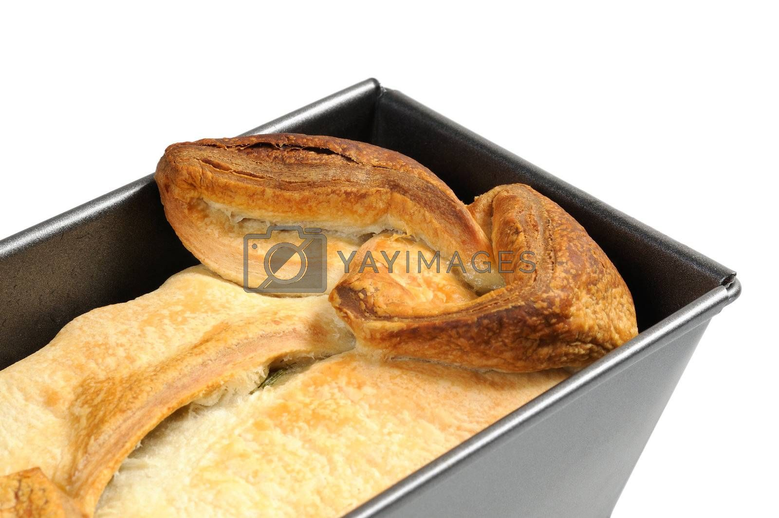 Bakery of puff pastry in the metallic form. Isolated on white background.
