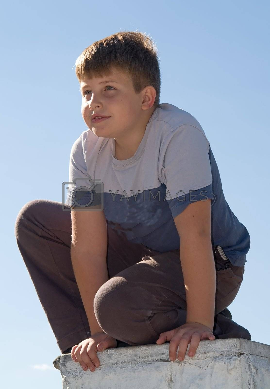 little boy with blue sky at background
