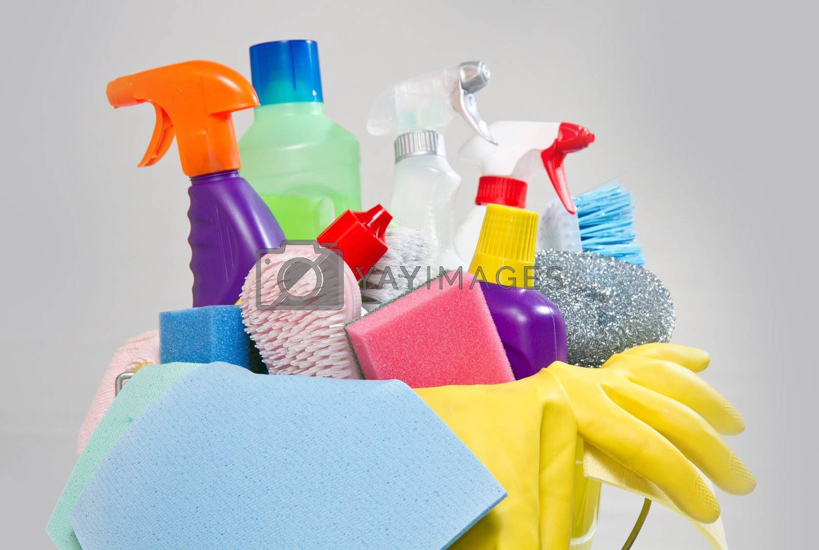 full box of cleaning supplies and gloves isolated on white