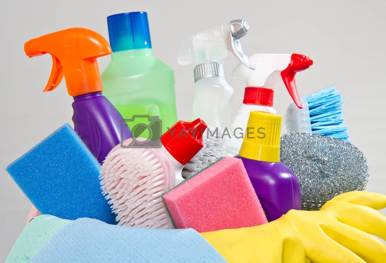 full box of cleaning supplies and gloves isolated on white by lsantilli
