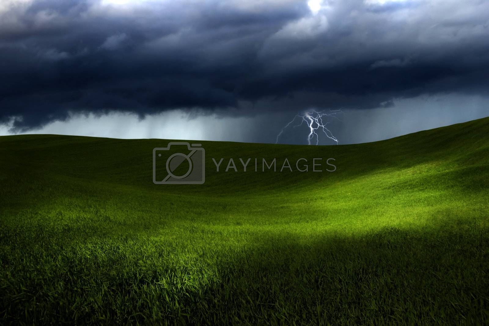 Beautiful green meadow with storm clouds and thunders