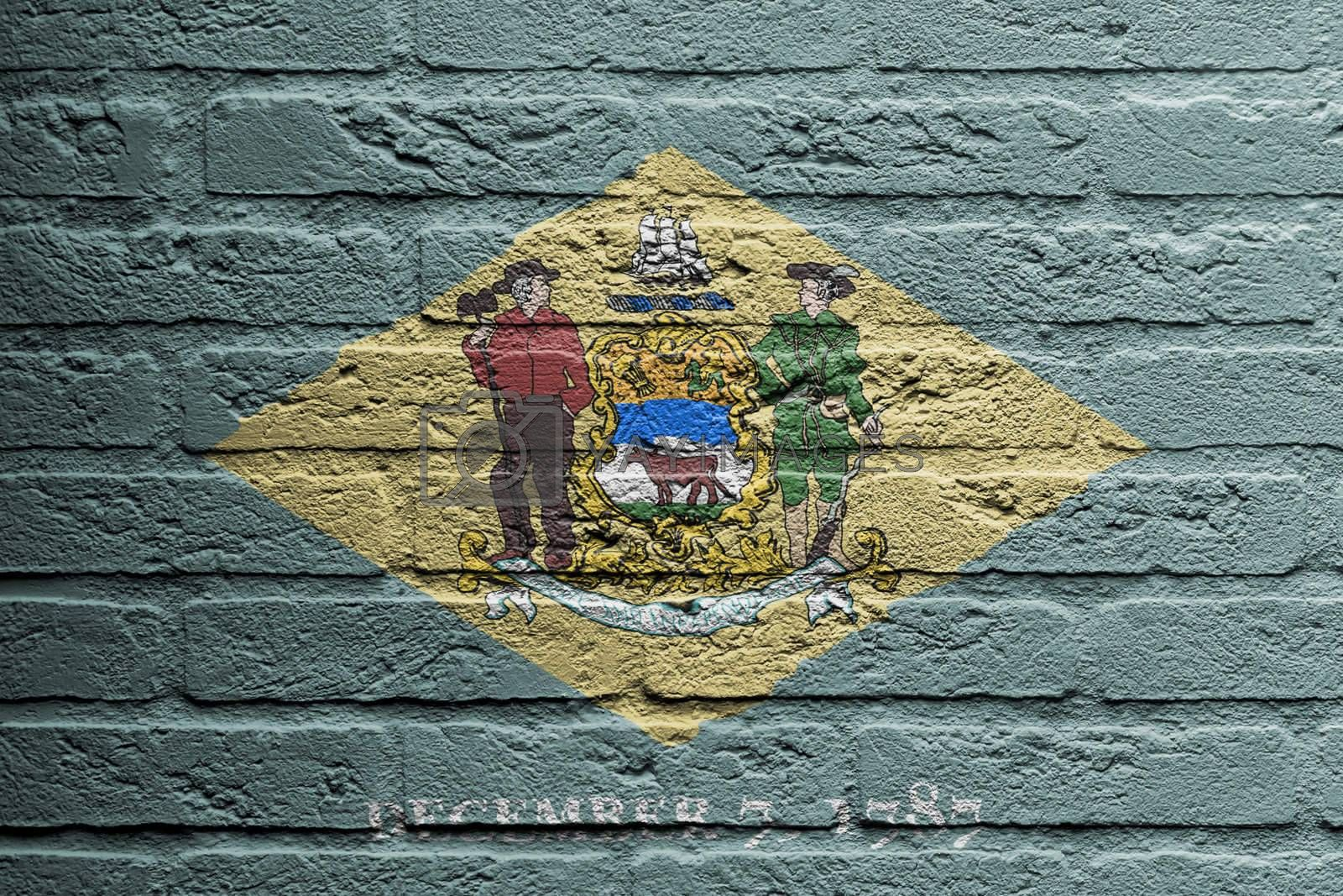 Brick wall with a painting of a flag isolated, Delaware