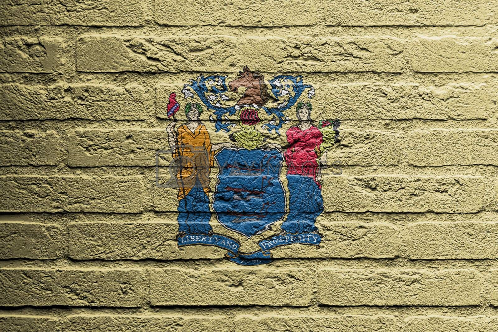 Brick wall with a painting of a flag isolated, New Jersey