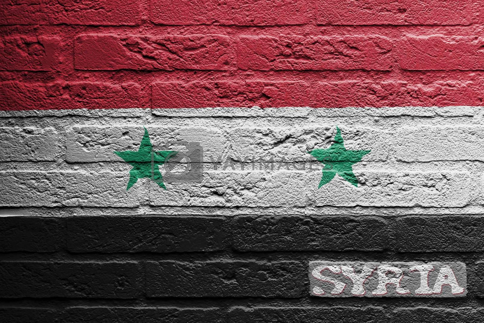 Brick wall with a painting of a flag isolated, Syria