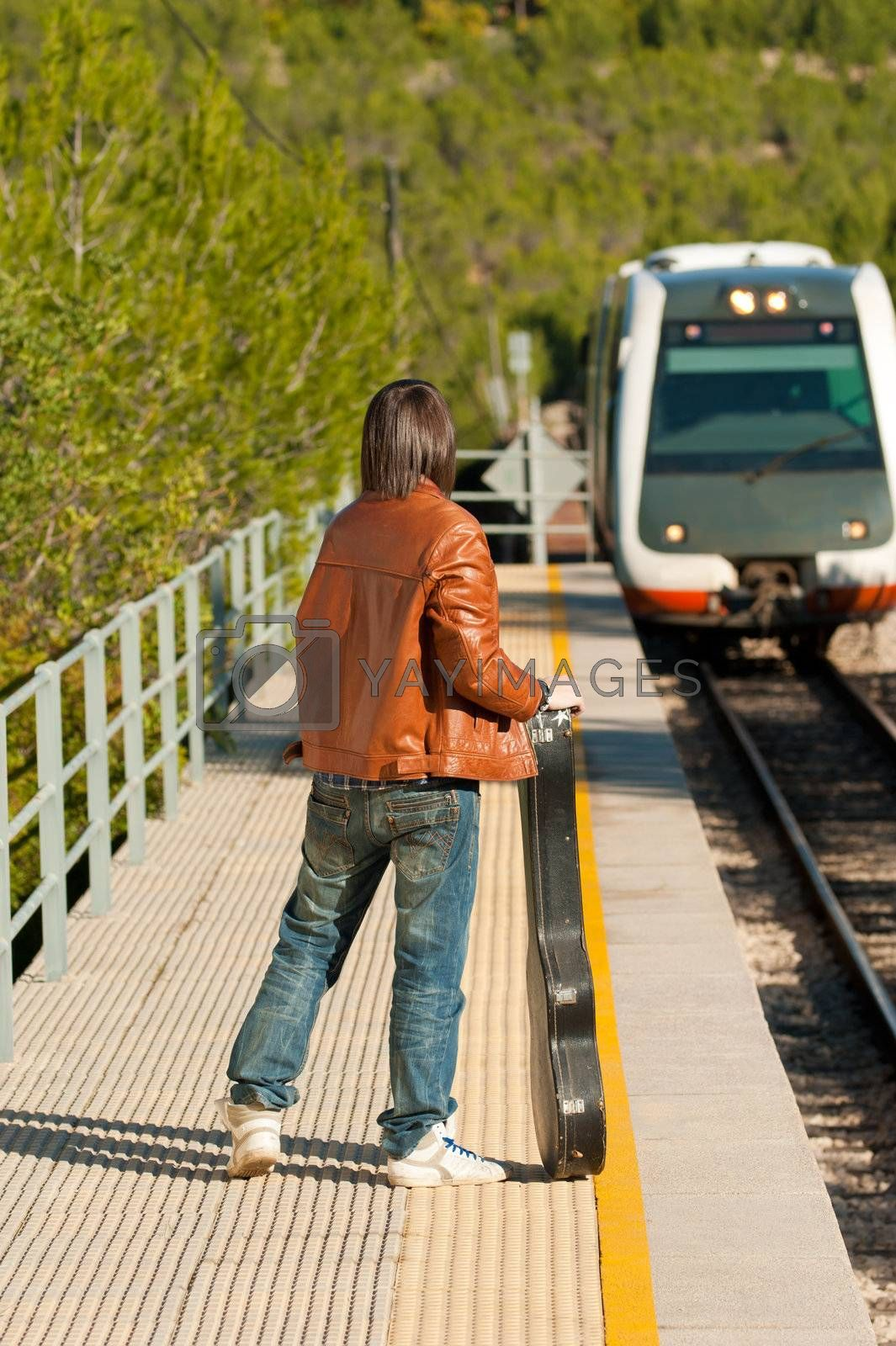 Commuter about to board an arriving train