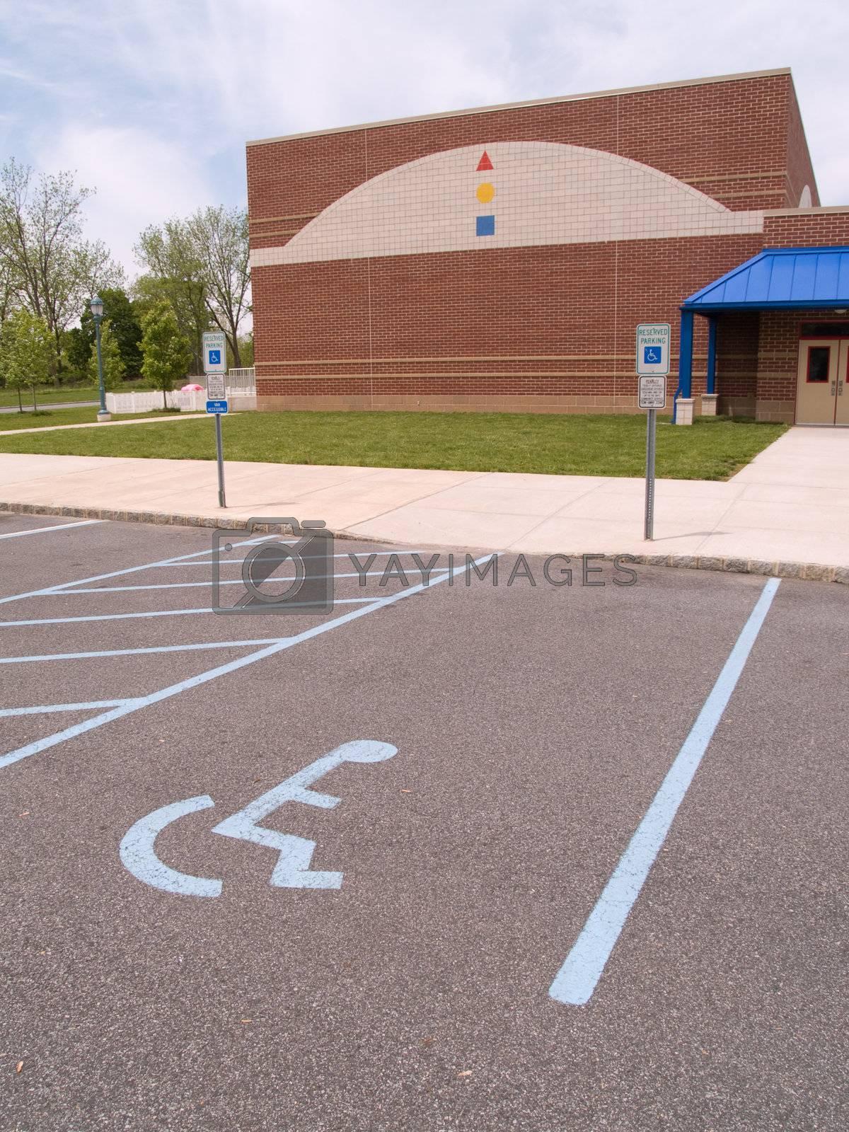 a handicapped parking spot by an school