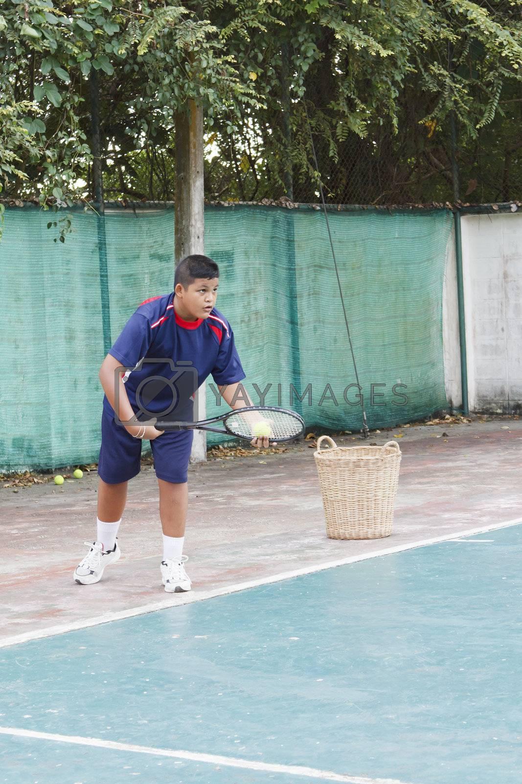 Thai boy tennis practicing