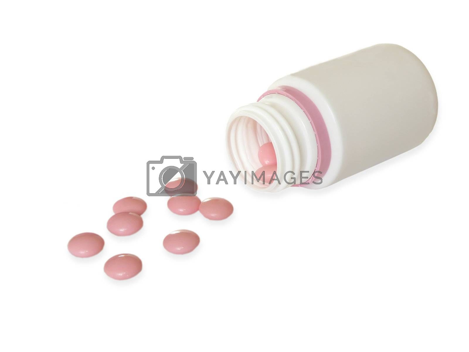 Pink pills and white bottle isolated