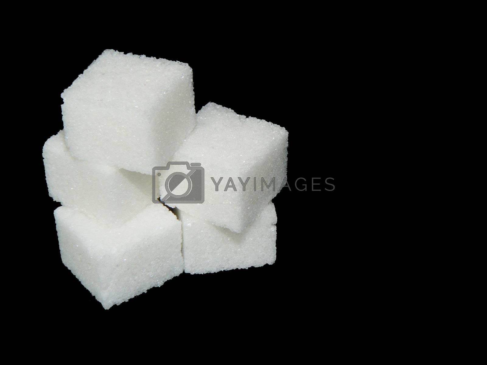 group of sugar cubes on black background