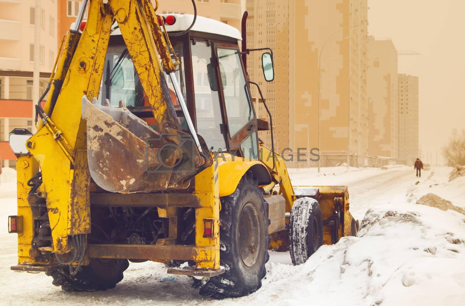 yellow snow plow on an empty street