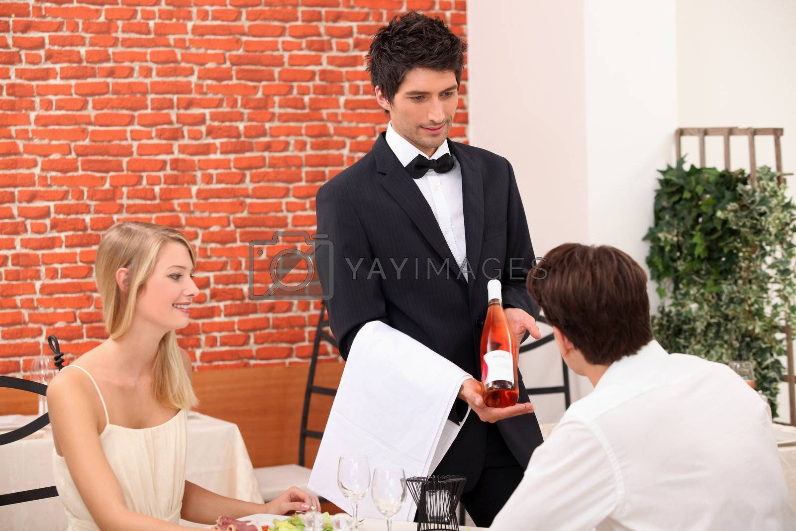 Young couple choosing rose wine in a restaurant