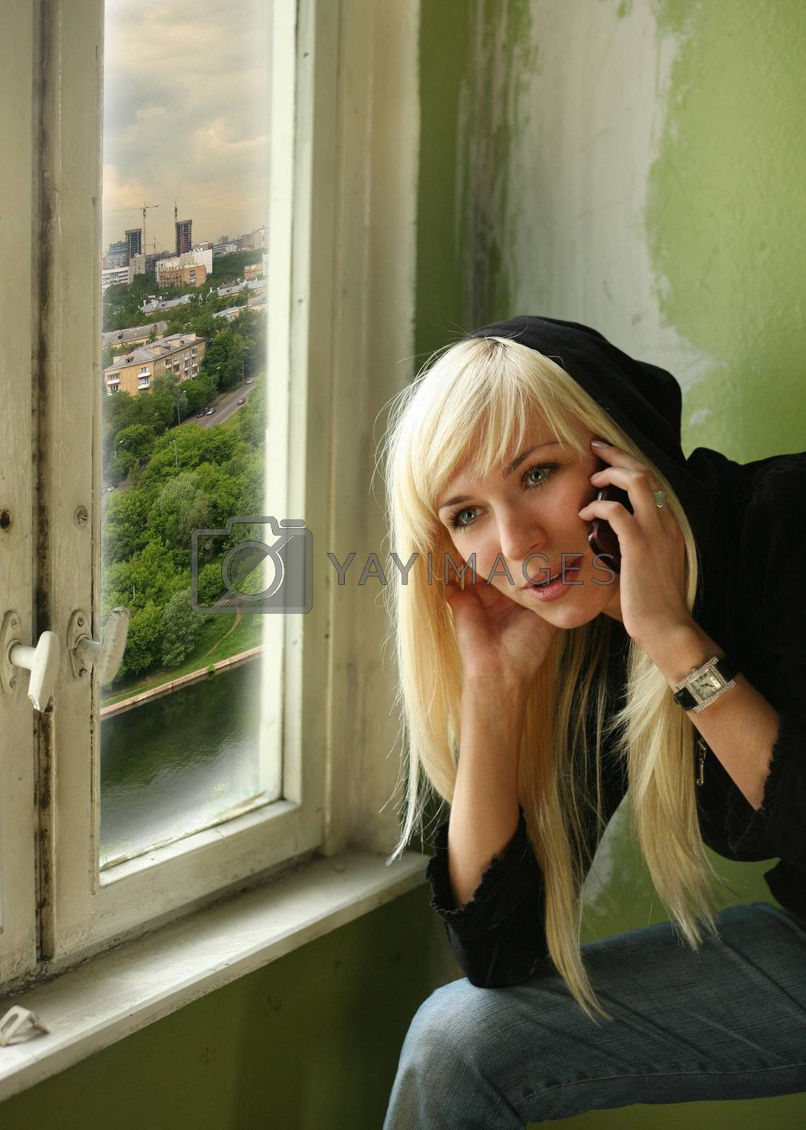 Pretty smiling blonde with the phone