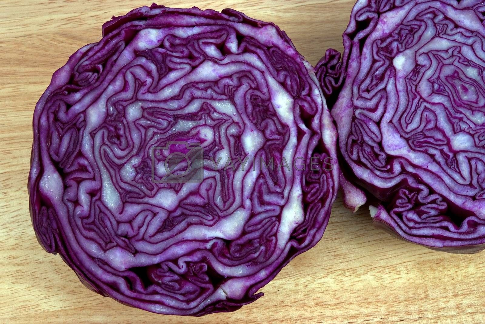 Red cabbage cut in half showing the growth pattern