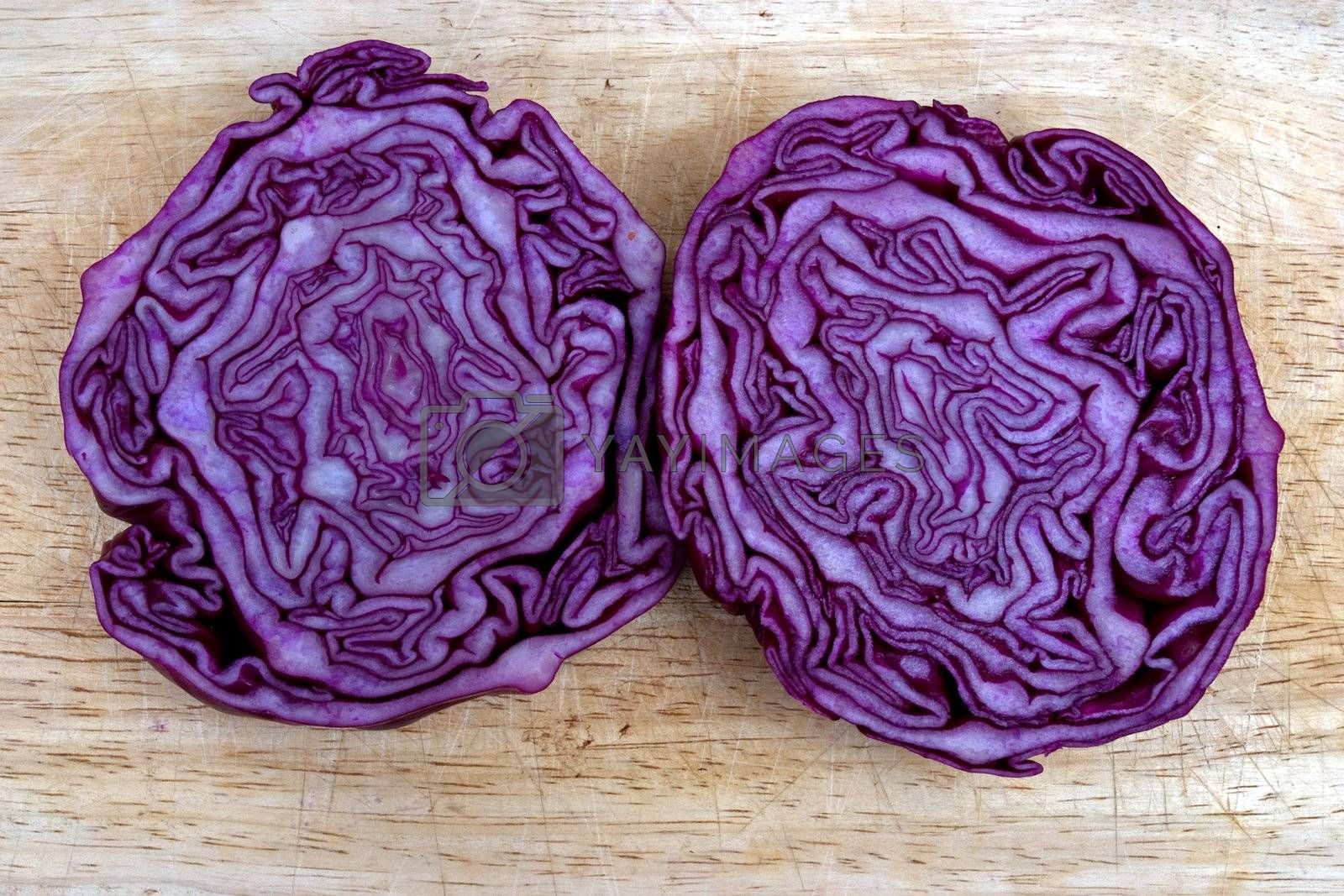 Red cabbage cut in half looking like a brain