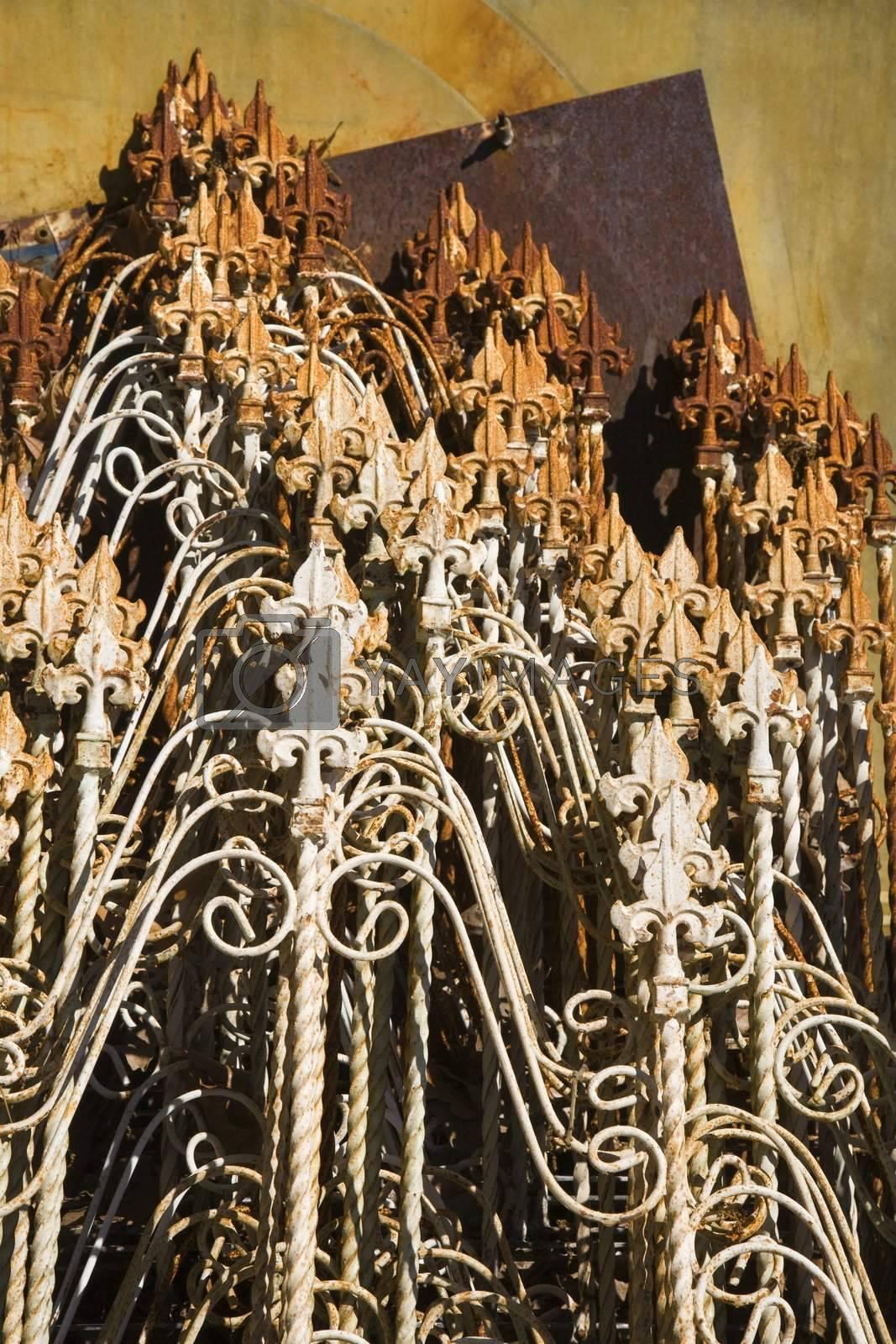 Metal fencing spires stacked together.
