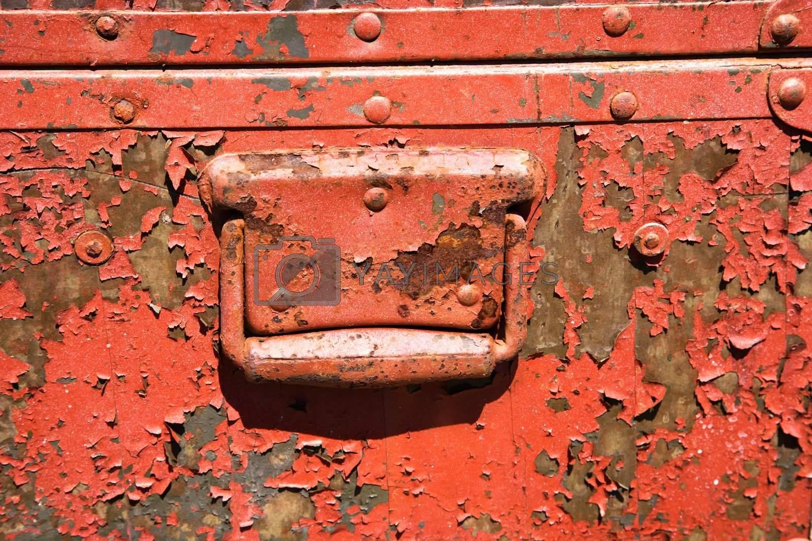 Old orange weathered metal storage container.