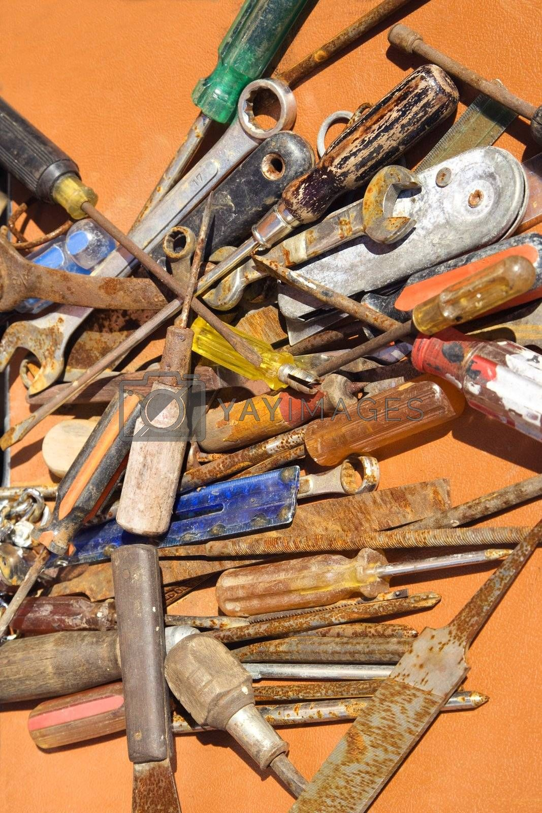 Old rusty tools lying on table.