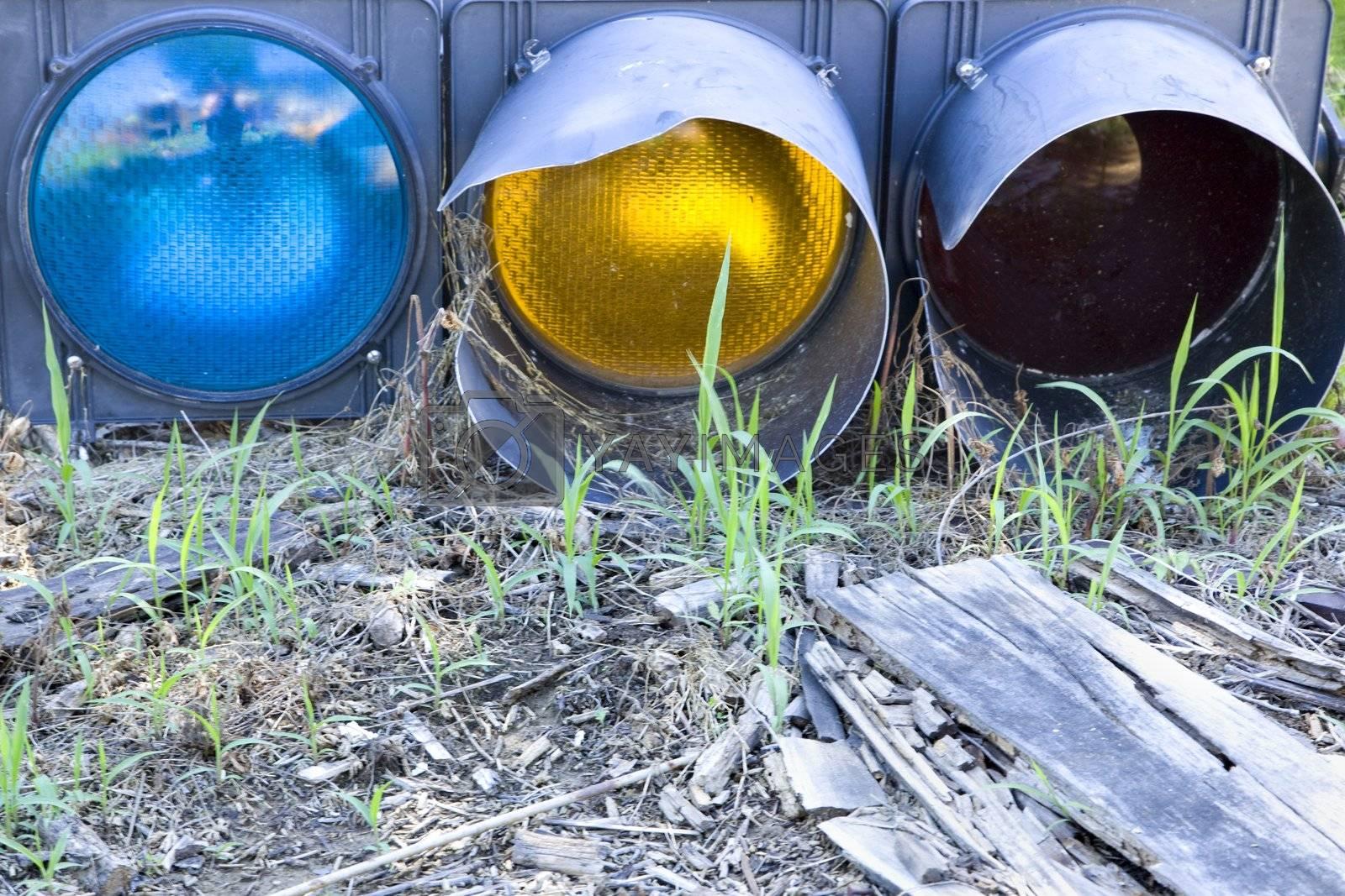 Old traffic light on ground.