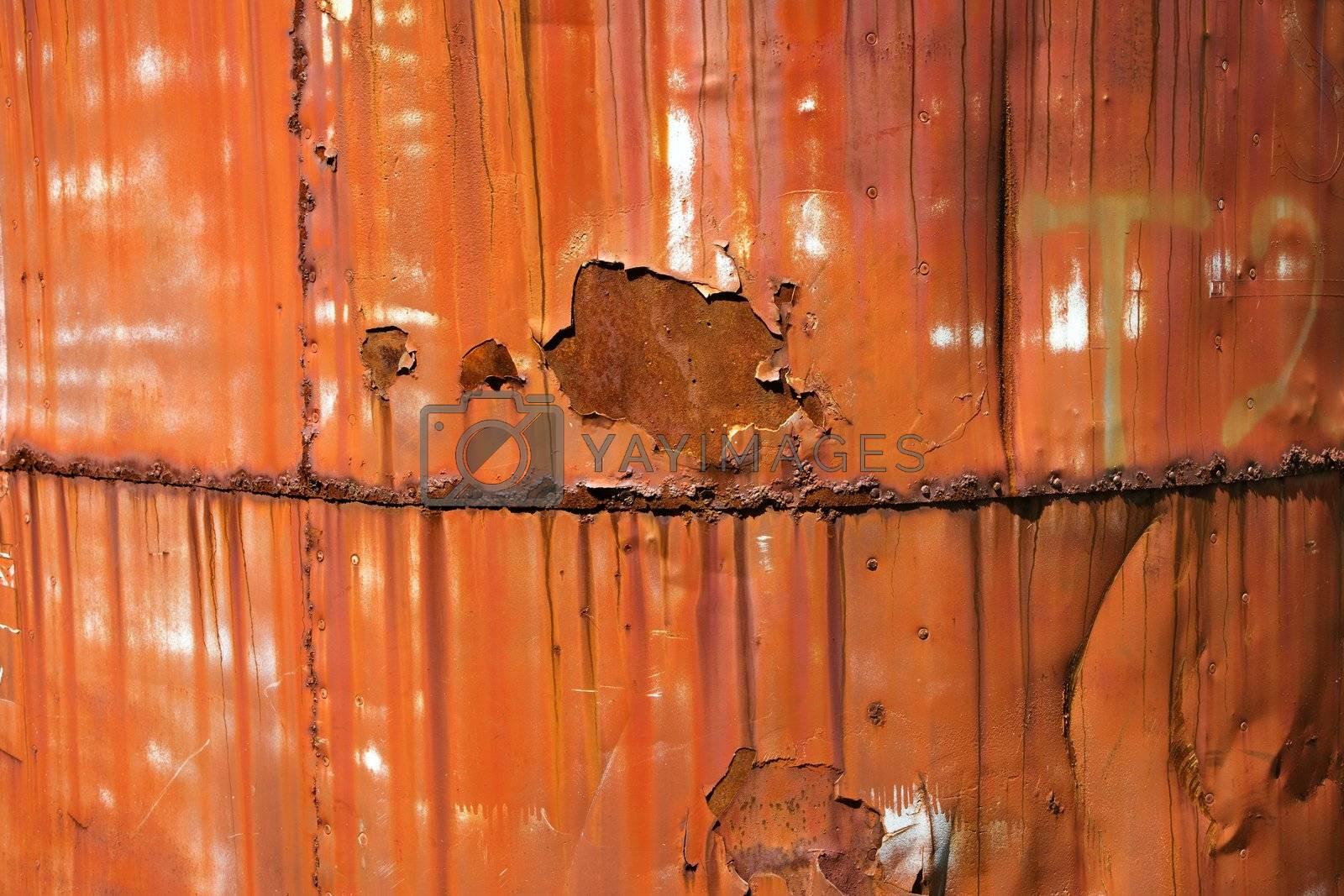 Closeup of metal orange container.