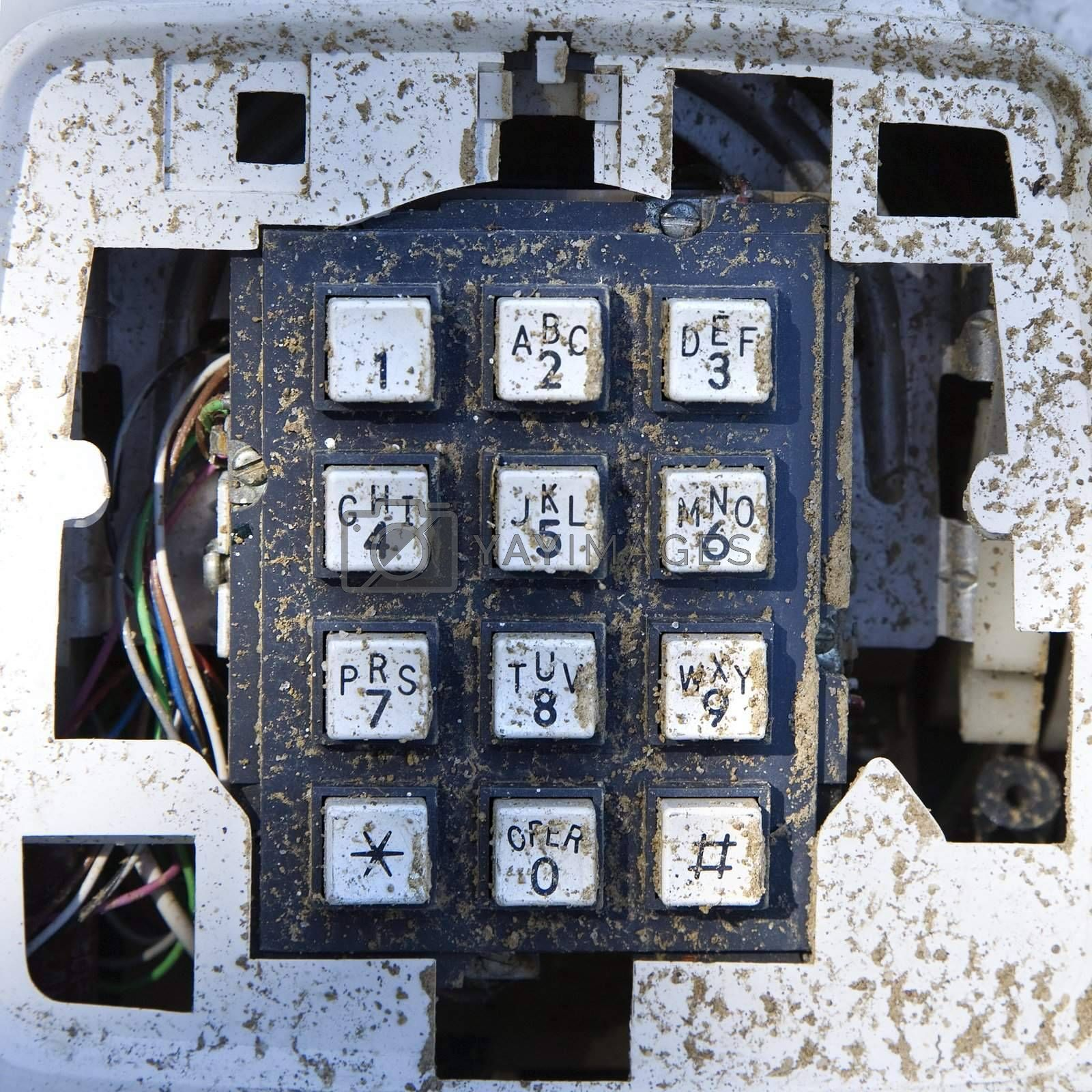 Closeup of old dirty telephone keypad.