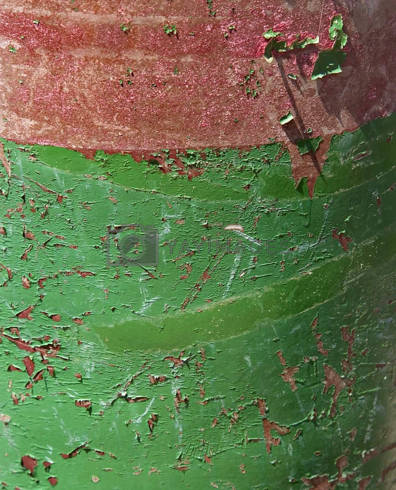 Closeup of green and red rusted container.