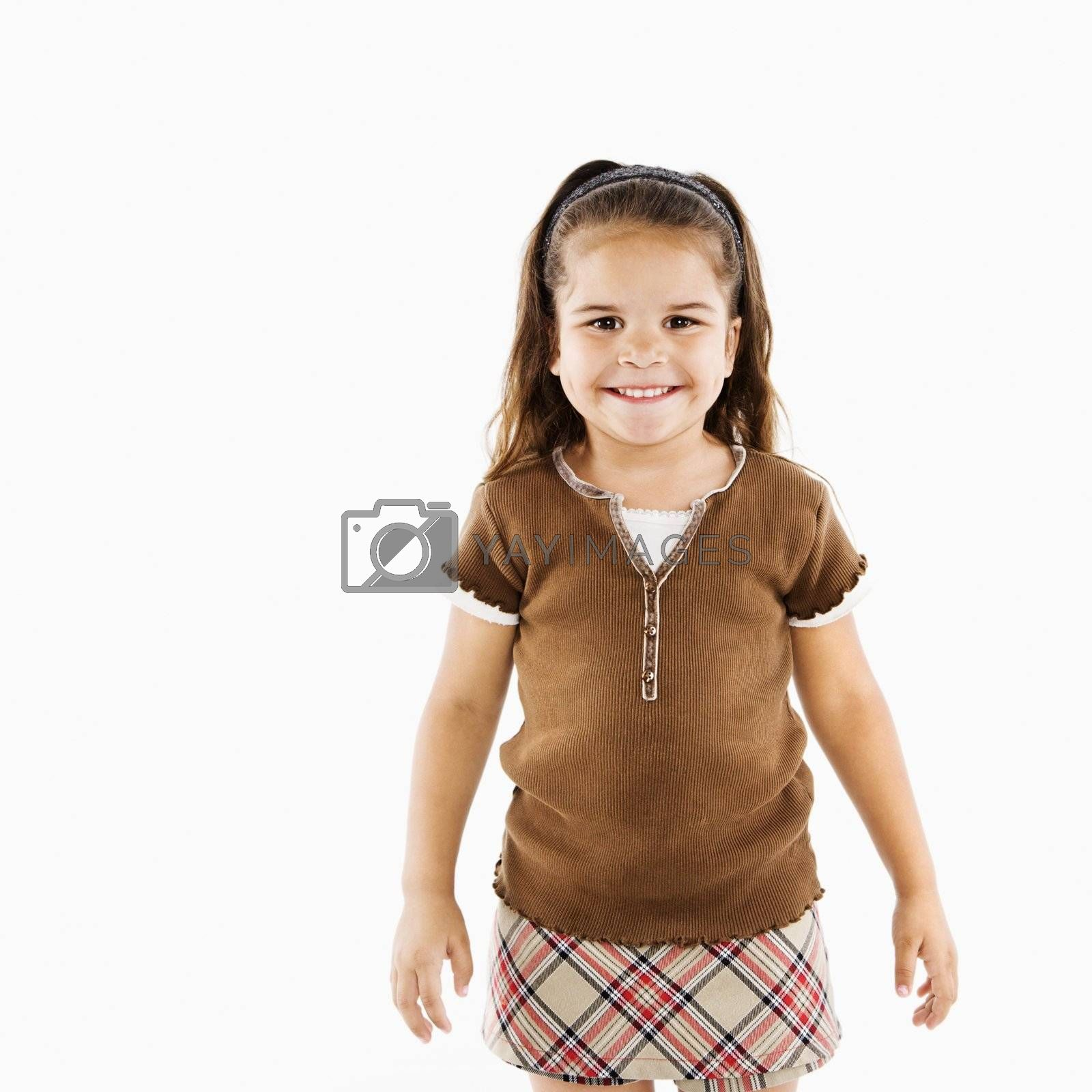 Adorable little hispanic girl standing smiling.