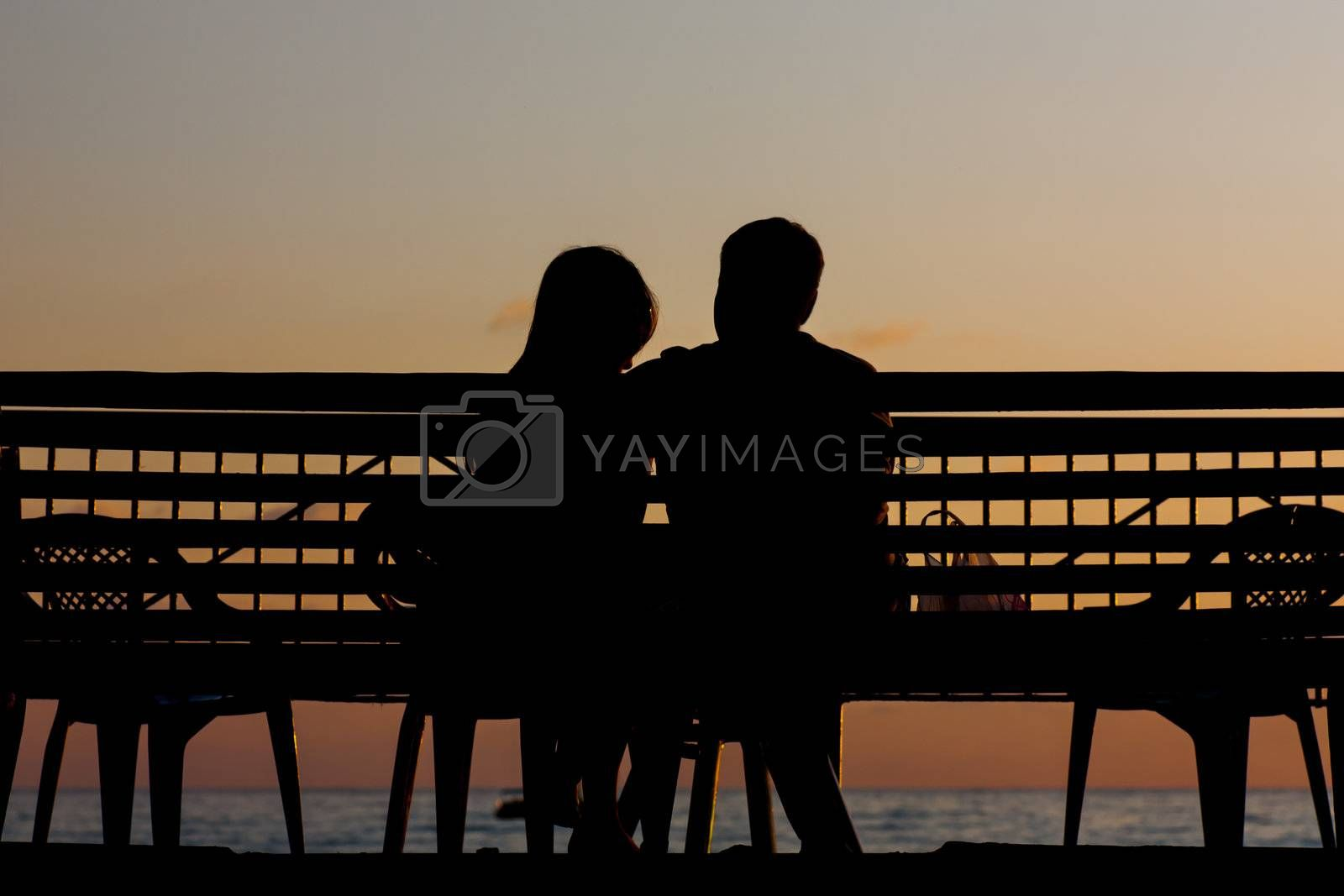 Silhouette of a young couple on a beach at sunset