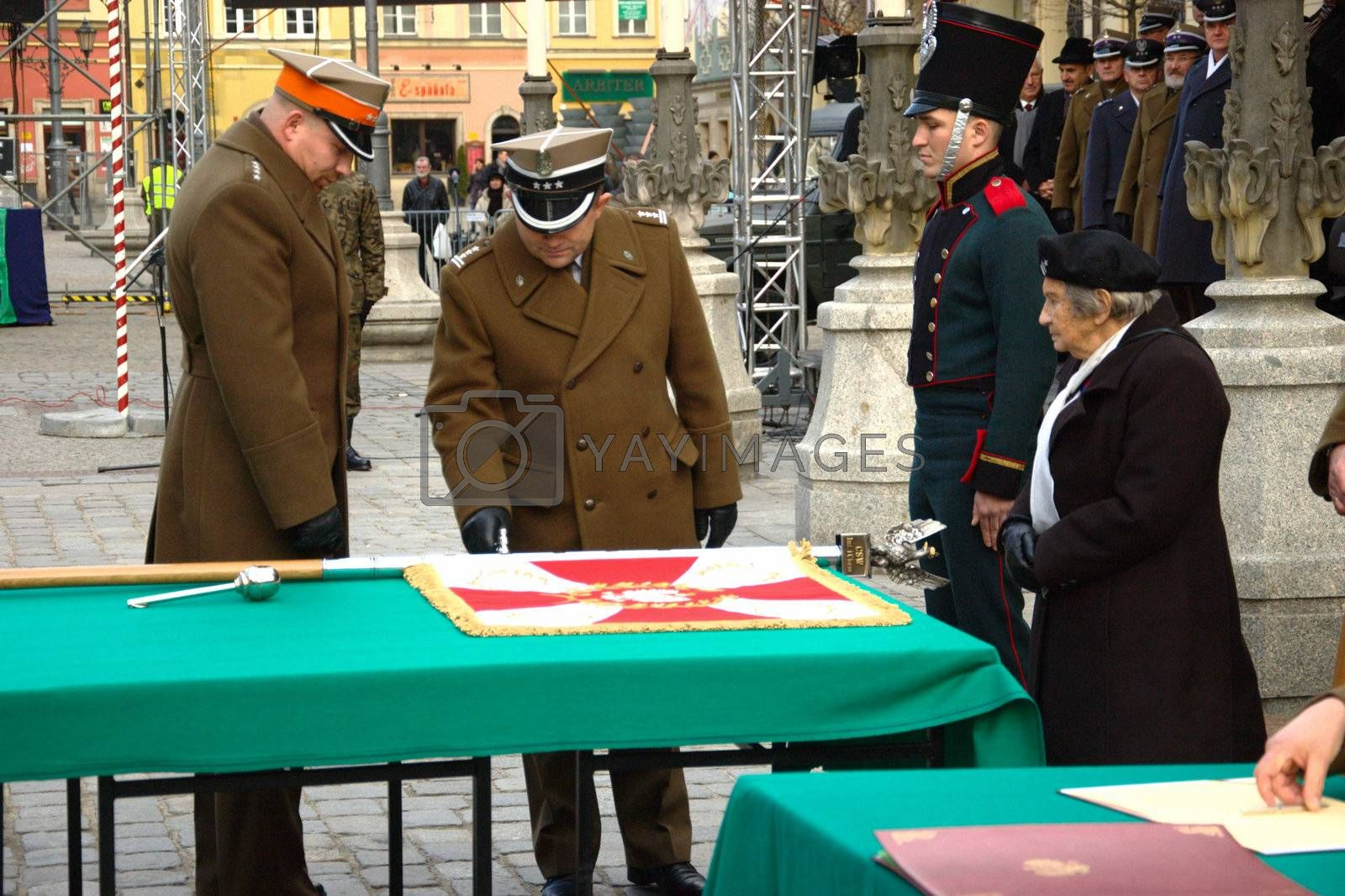 WROCLAW, POLAND - DECEMBER 2: Polish army, engineering training center for troops receives new army banner. Officer blesses new banner on December 2, 2011.