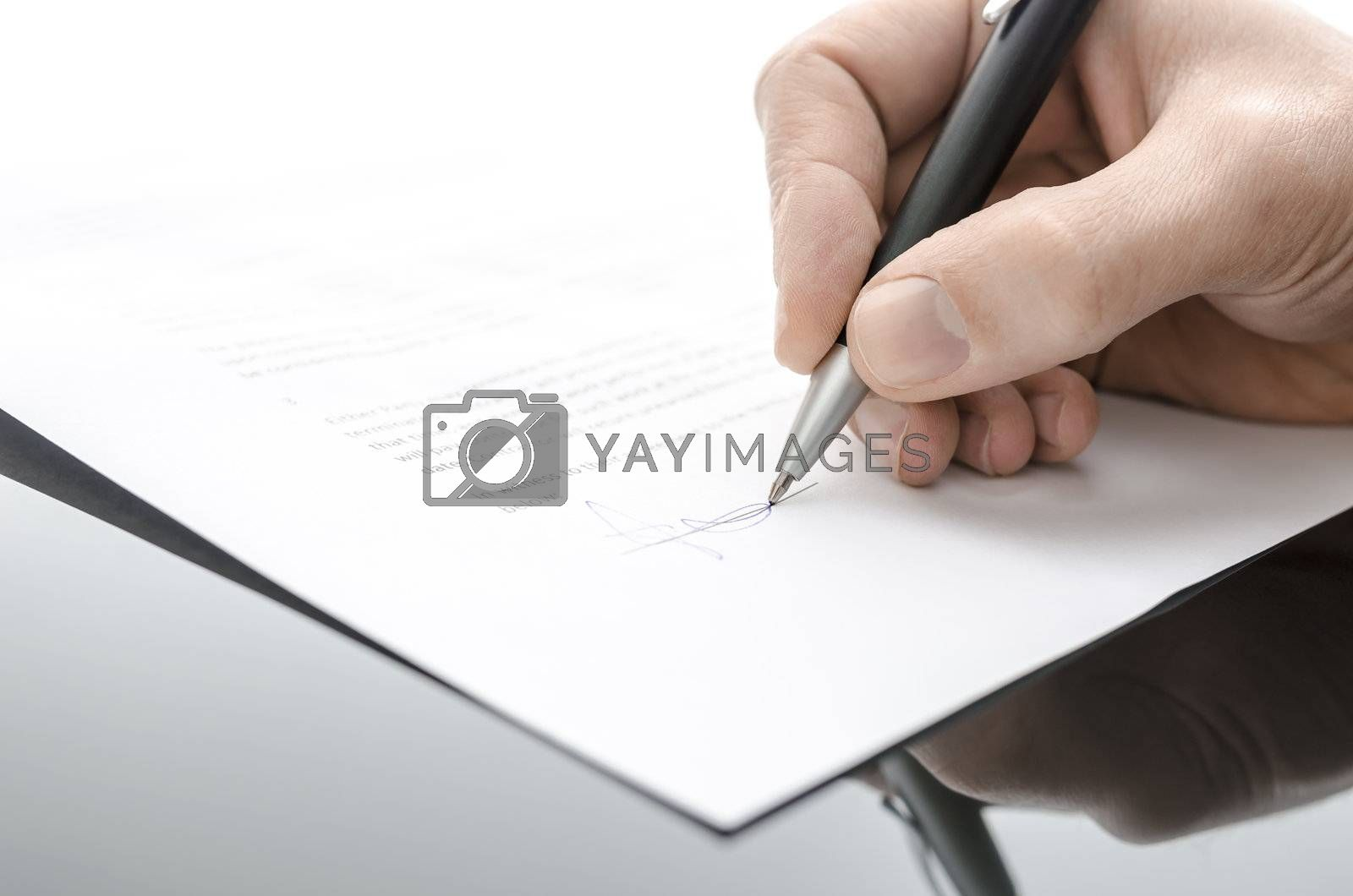 Male hand signing a contract on a black table by Gajus
