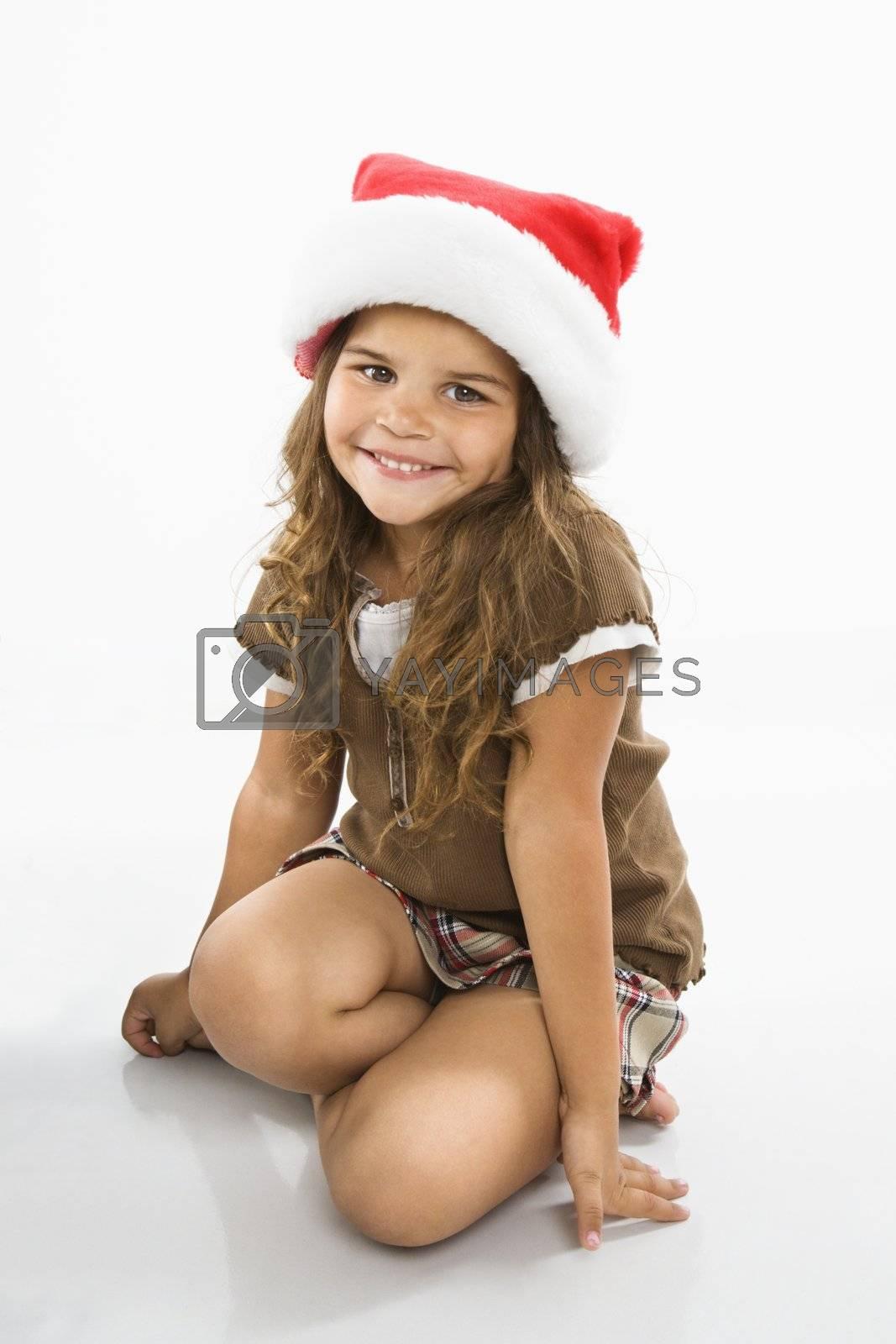 Girl wearing santa cap by iofoto