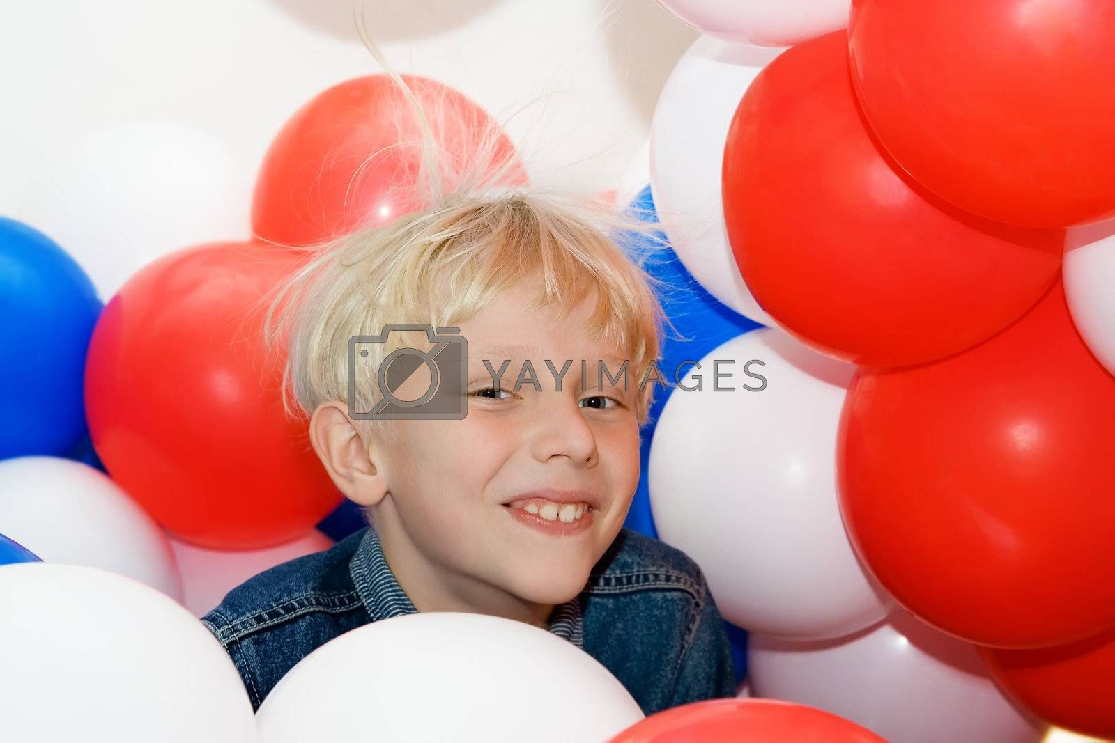 Smiling Boy with Balloons on White Background