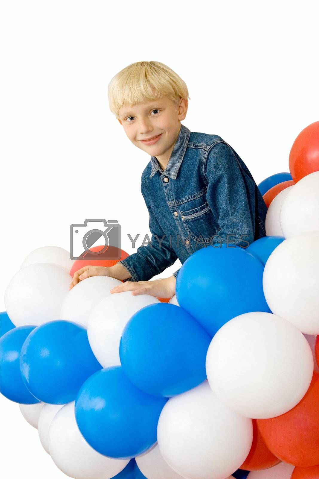 a smiling boy with balloons on white background